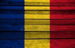depositphotos_81558748-stock-photo-romania-flag-on-wood.jpg