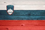 depositphotos_102915172-stock-photo-slovenia-flag-on-wood-plank.jpg